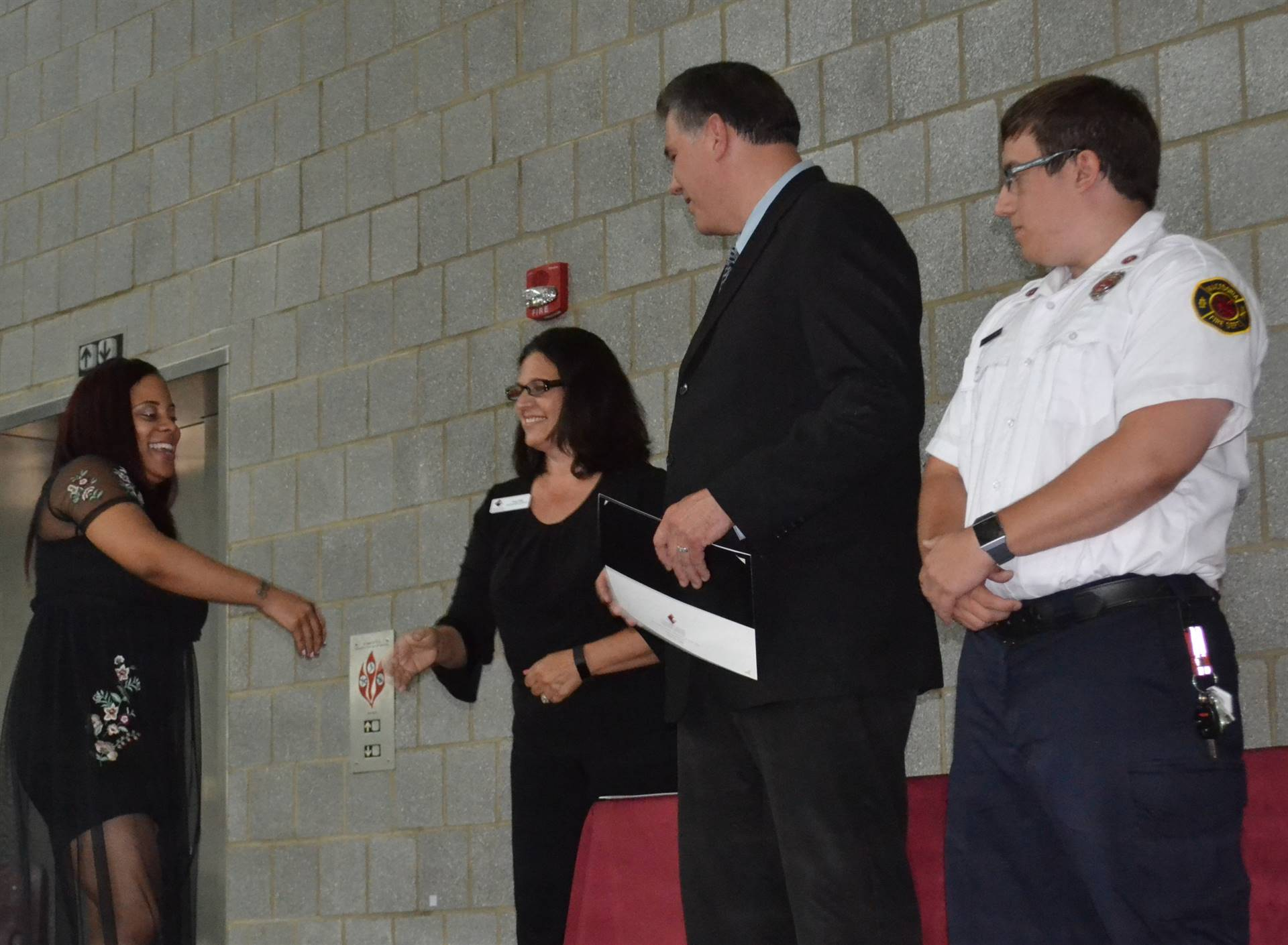 EMT student receiving certificate
