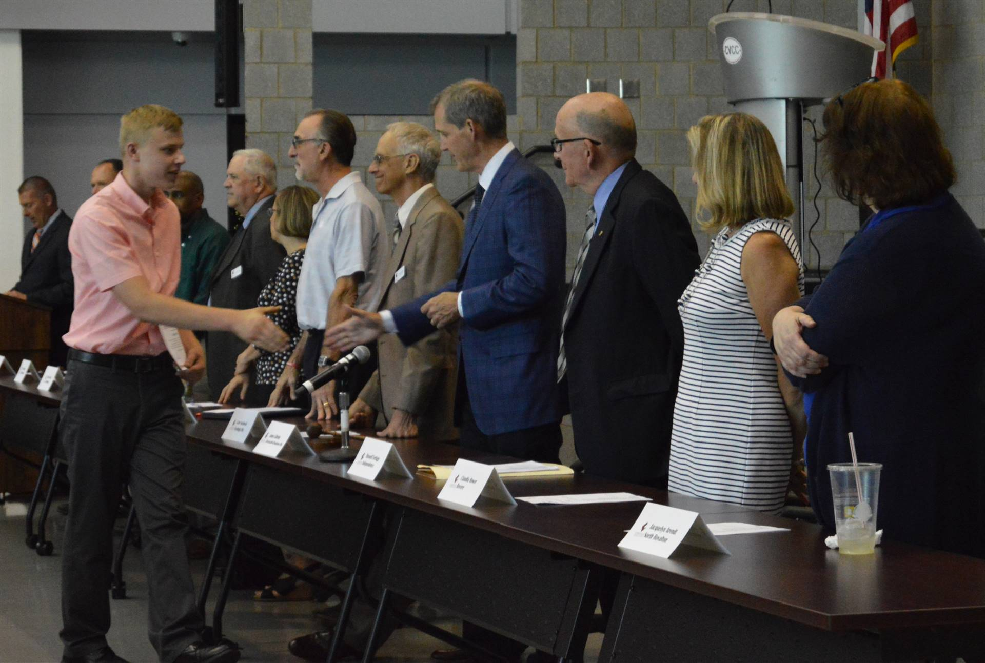 Students shaking hands with Board members
