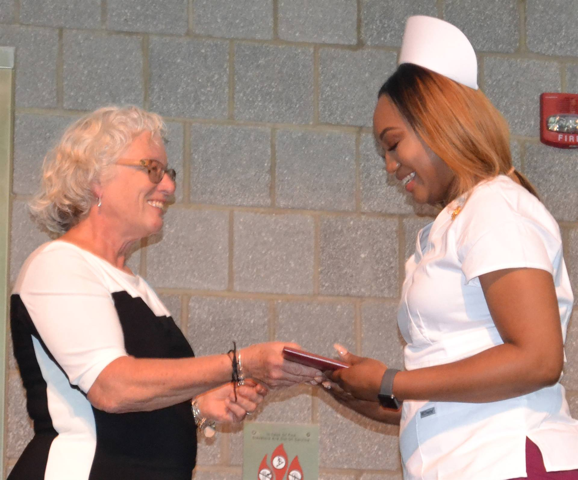 Nursing student receiving diploma at graduation ceremony June 7, 2018