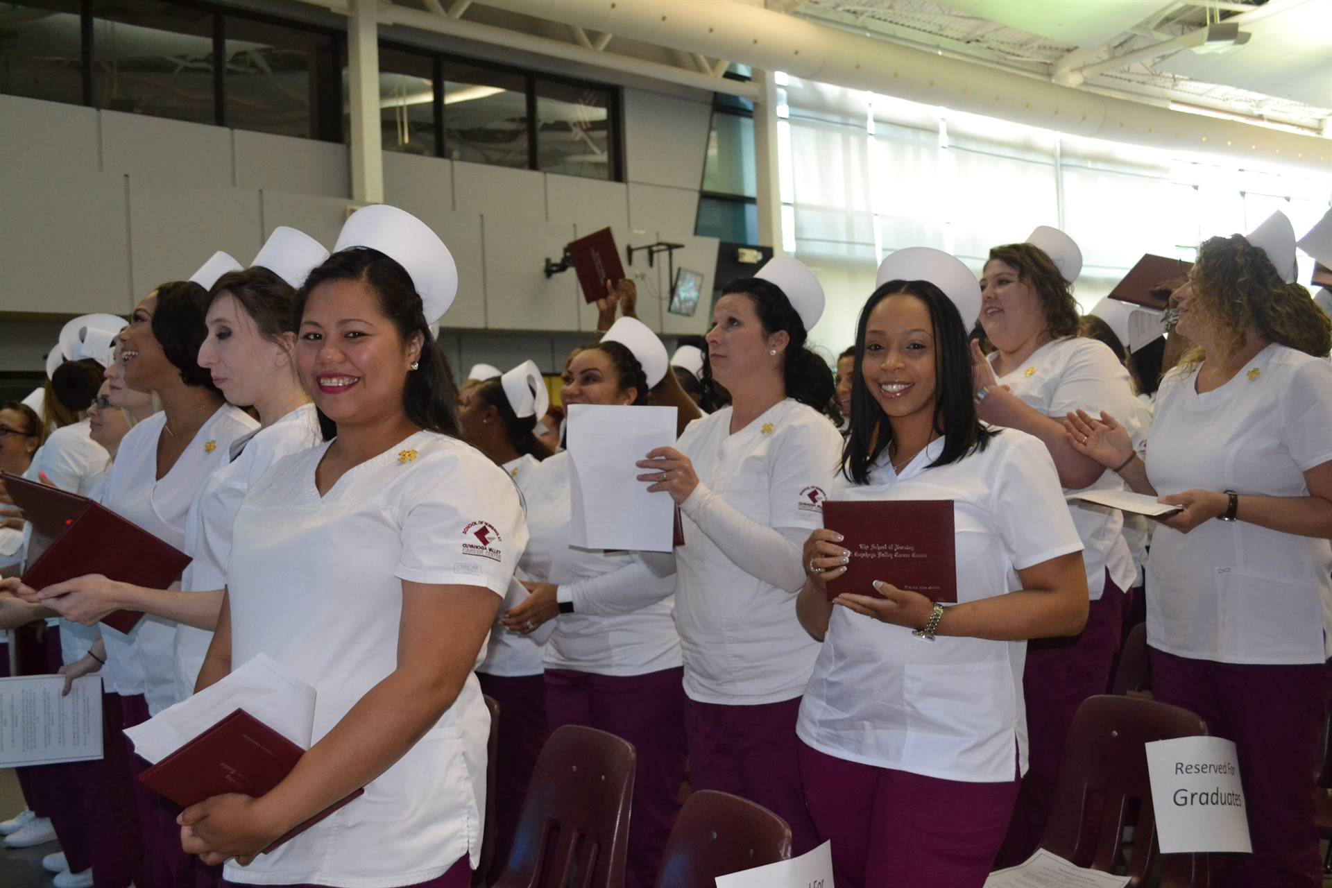 Nursing students with diplomas