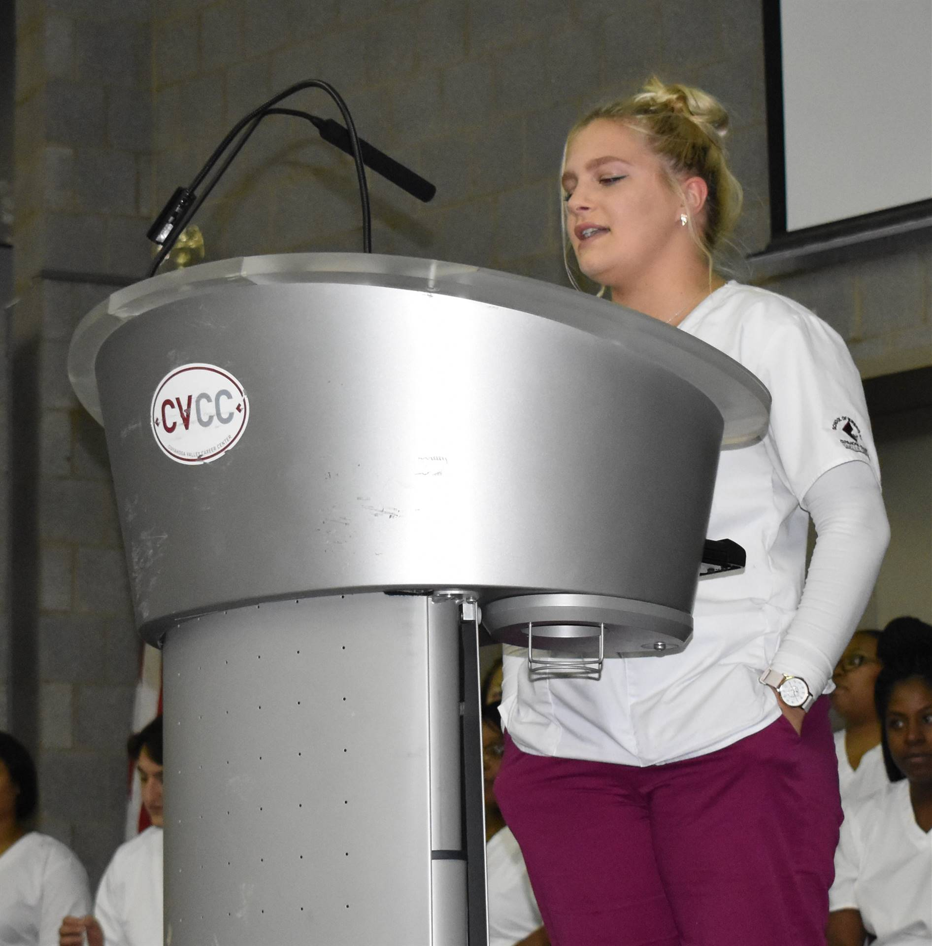 nursing student at podium