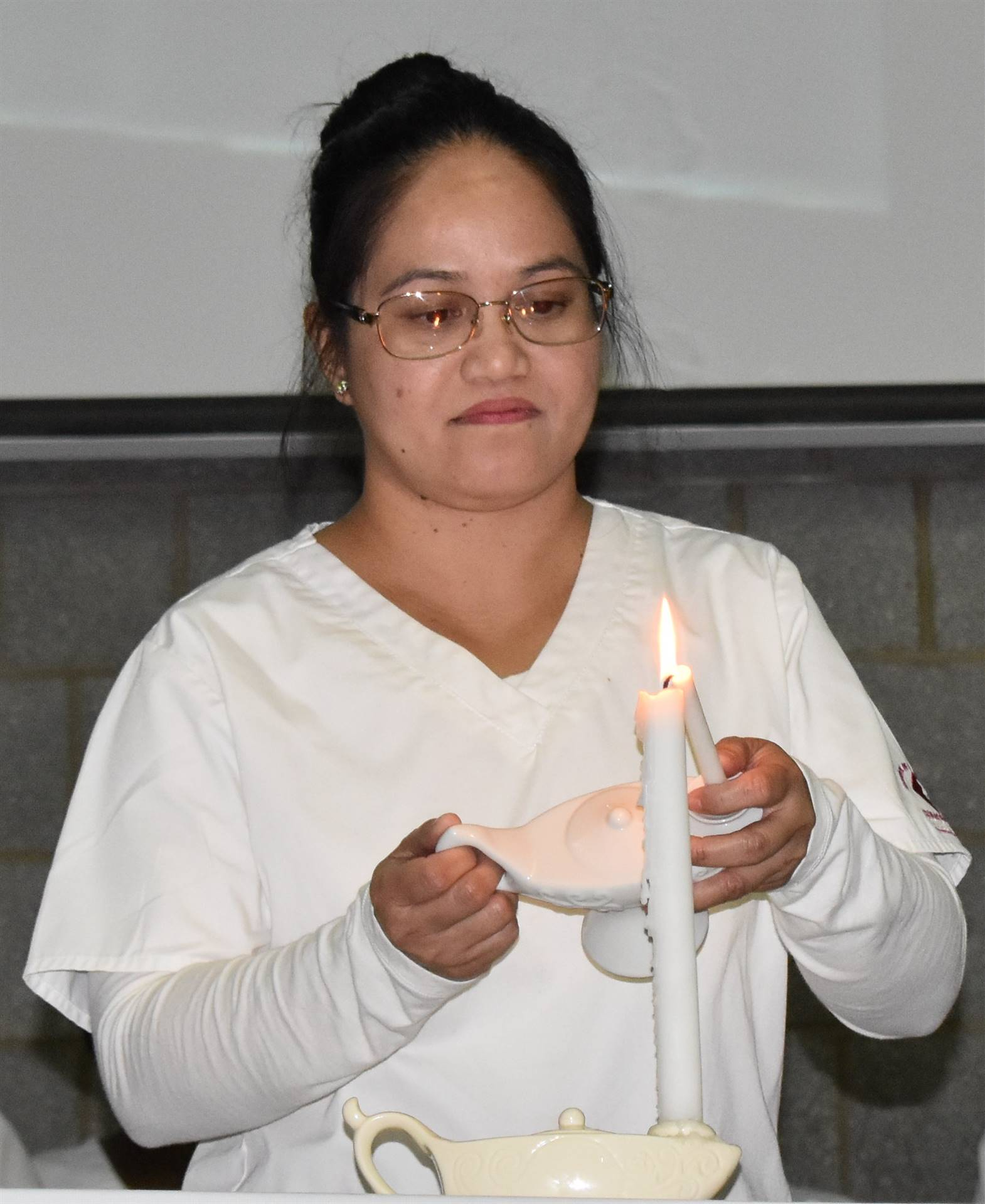 nursing student lighting candle