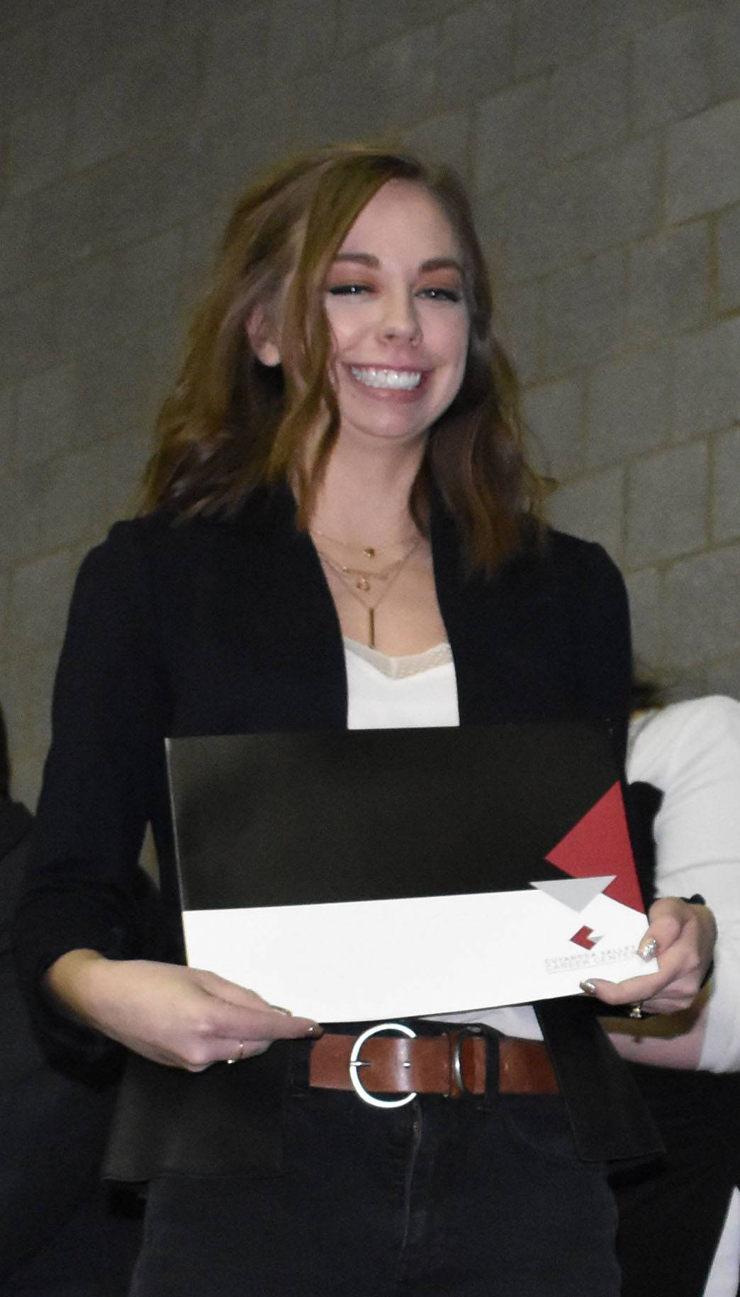 smiling student with certificate