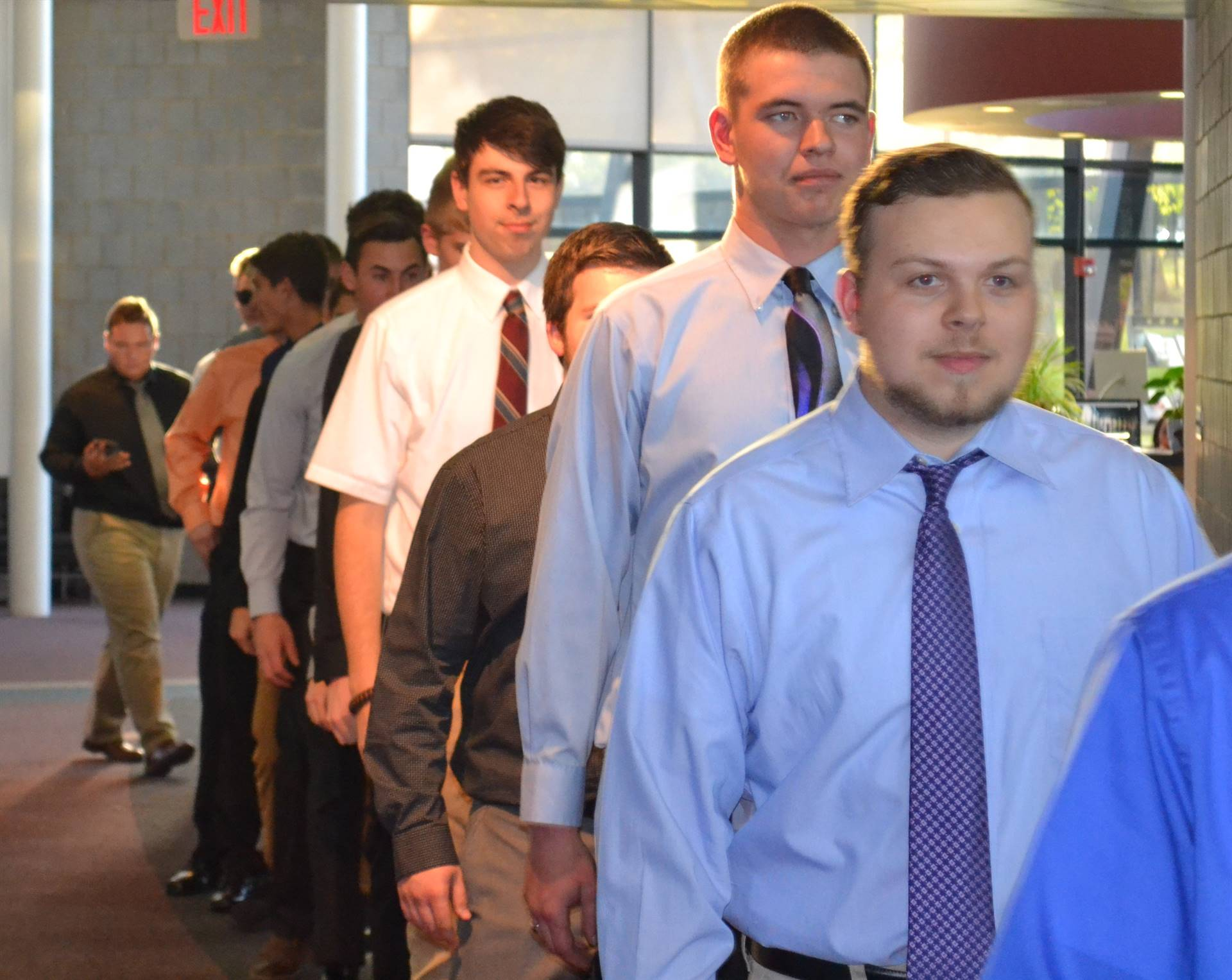 instructor with students entering Commons