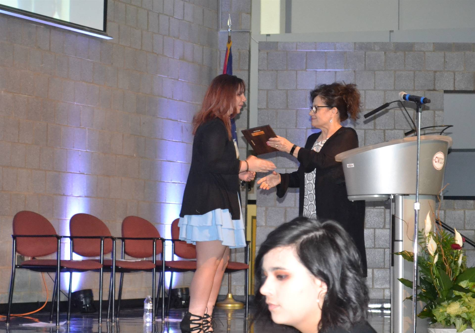 student crossing stage