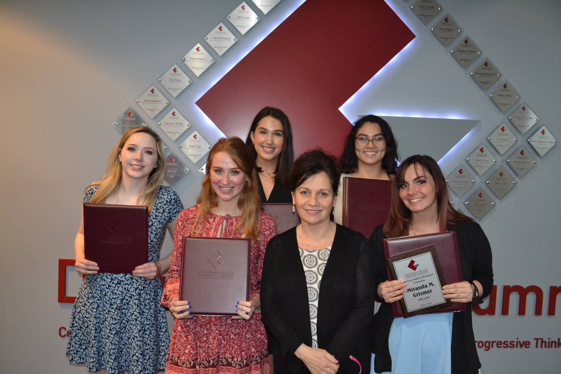 group picture of students with portfolios and instructor