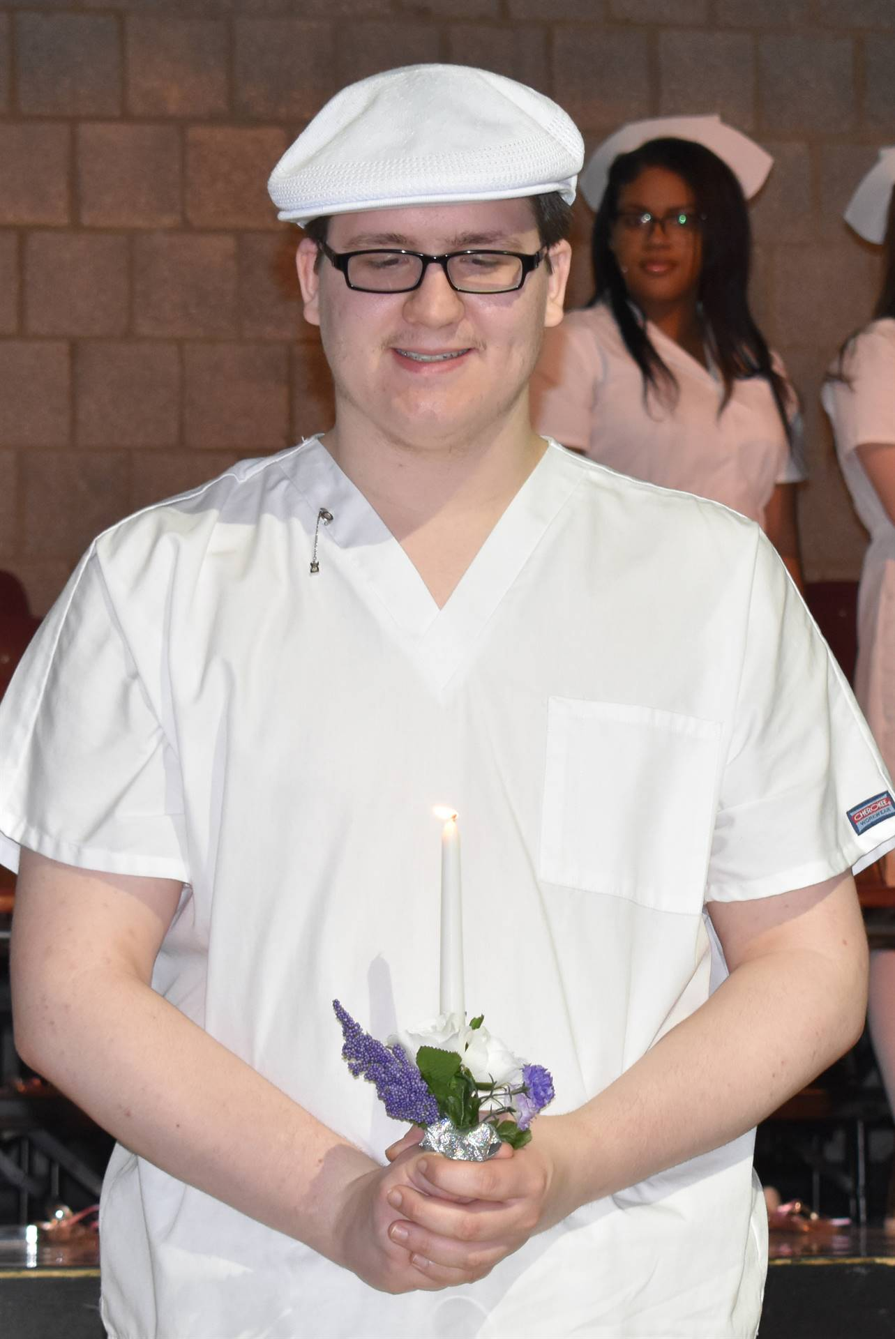 student with candle