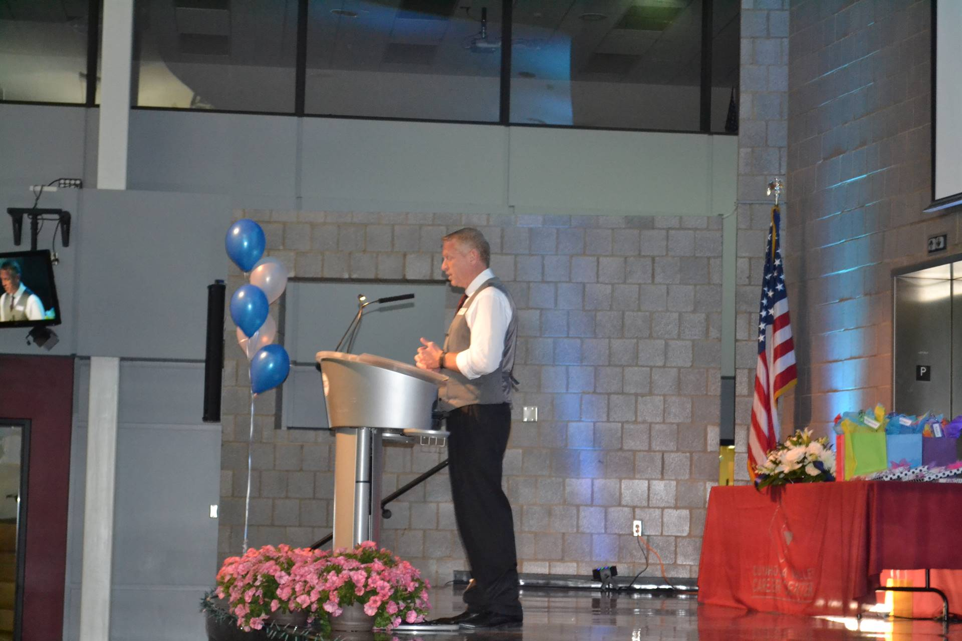 assistant principal welcomes guests