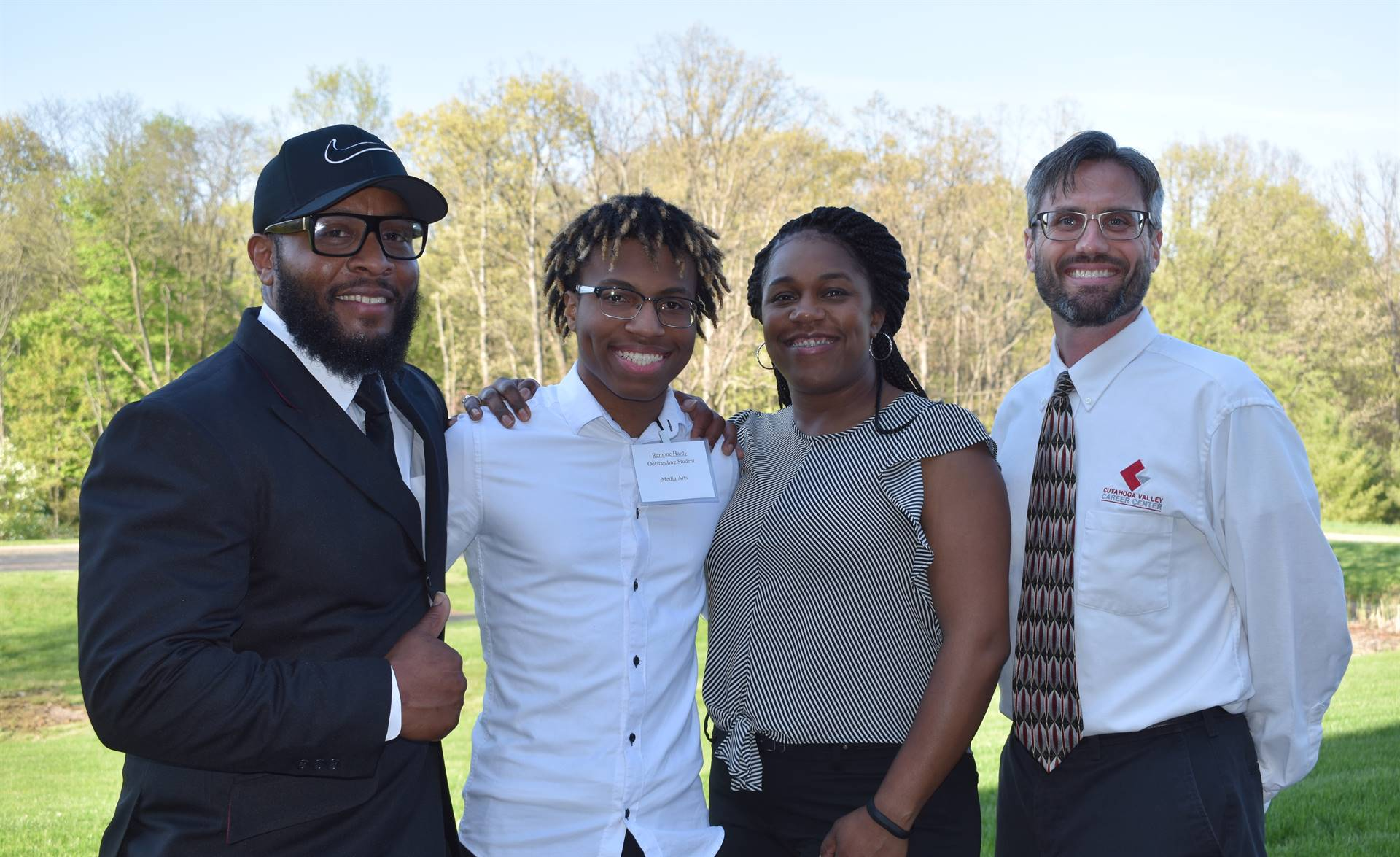 student with family and instructor