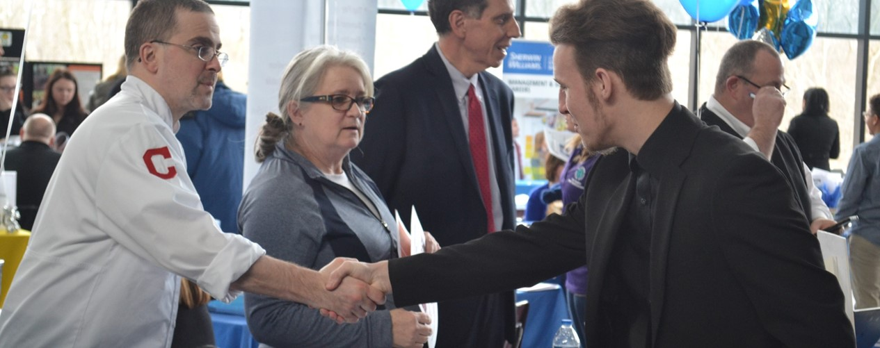 Student shaking hands with business owner during Job Fair